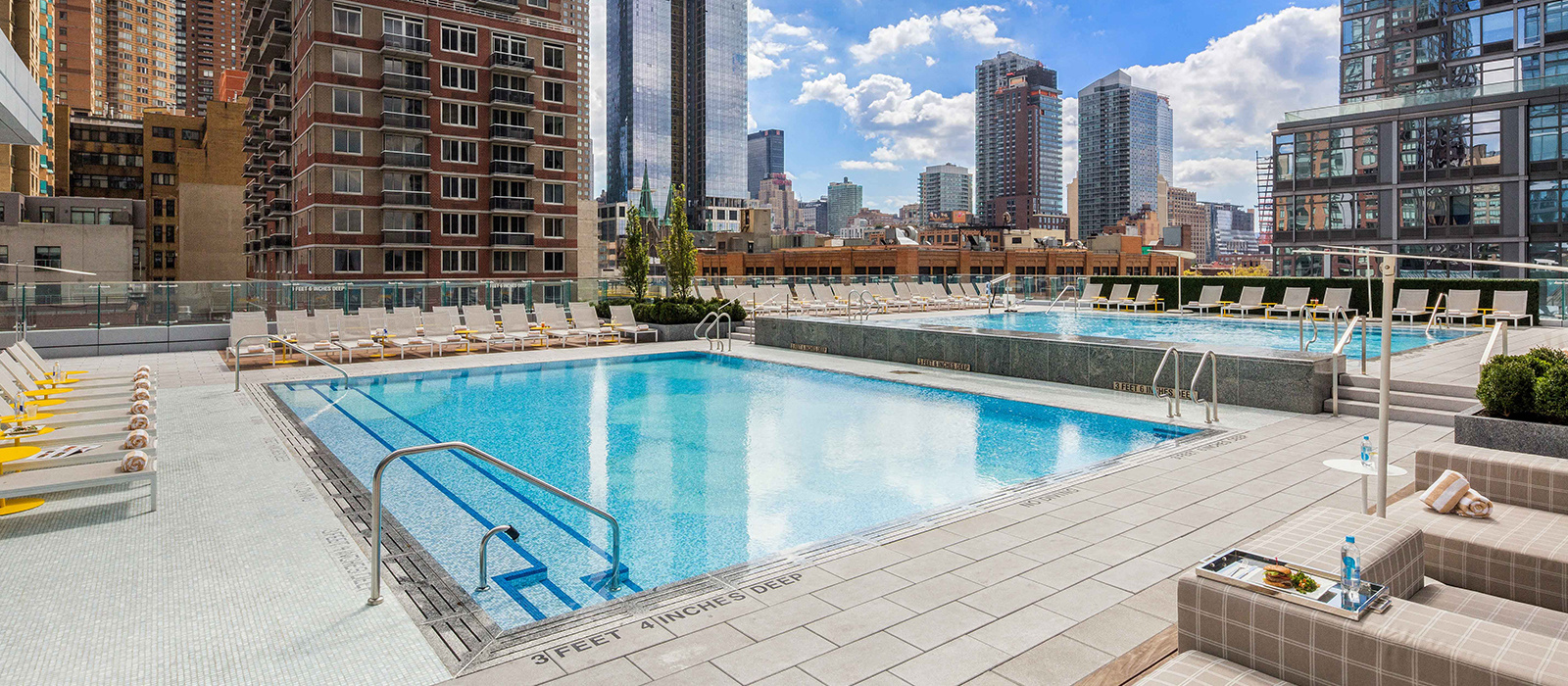 Luxury Apartments Pool. Live in sophisticated modern style Sky NYC Luxury Apartment Rentals